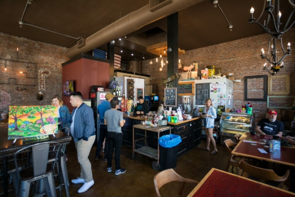 An interior shot of BREW with counter, tables and people
