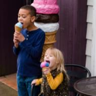 Independent Ice Cream Shop children enjoying ice cream cones