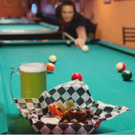 Arena Sports Bar and Grill pool table with beer and wings
