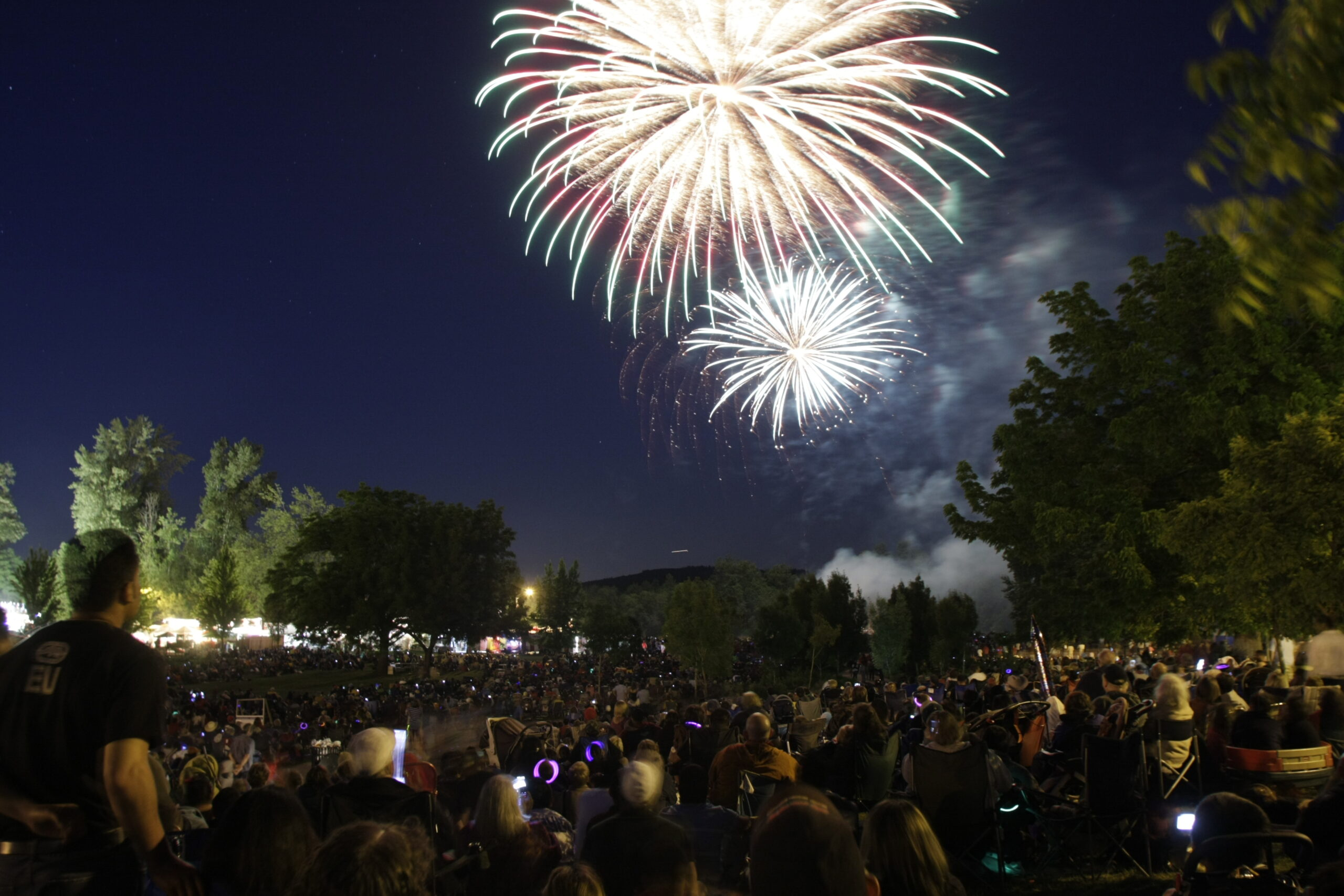 A large crowd watching fireworks