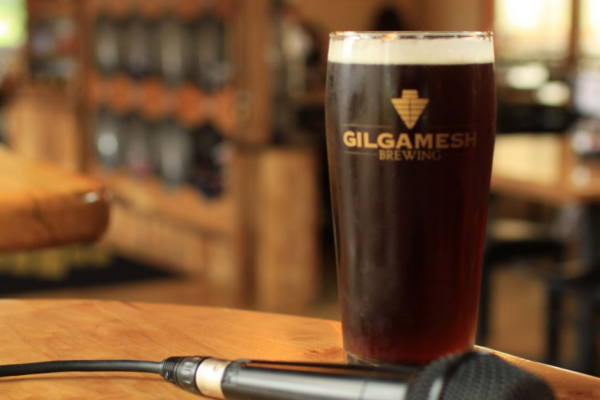 Shows Gilgamesh Stout with a microphone next to it at one of their live music shows