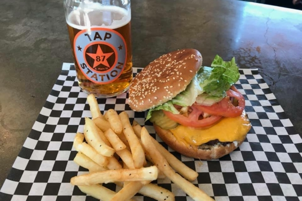 Burger, fries, and beer from the Tap Station