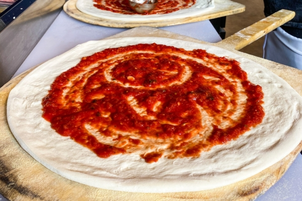 Image shows fresh pizza being made at Gilgamesh The River in Independence, Oregon