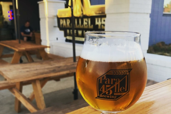 Image shows glass filled with beer from Parallel 45 in Independence, Oregon