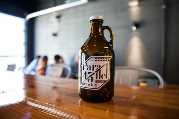 Image shows growlers available at Parallel 45 in Independence, Oregon